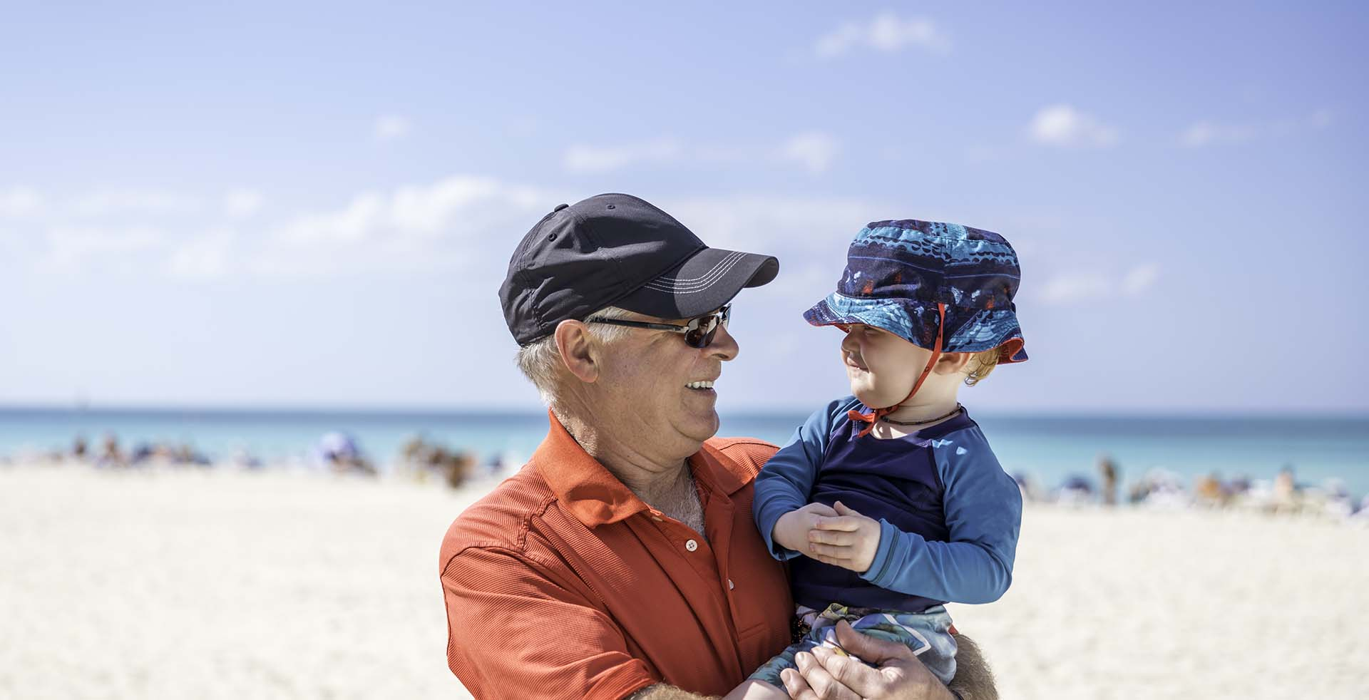 Man and toddler on beach