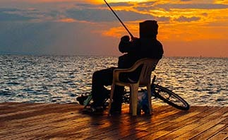 Man fishing on dock